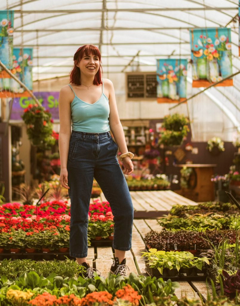 woman smiling in her flower nursery